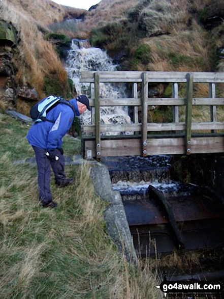 My mate Mike inpspecting Drainwater Workings on Binn Moor. Walk route map wy106 West Nab and Horseley Head Moss from Meltham photo