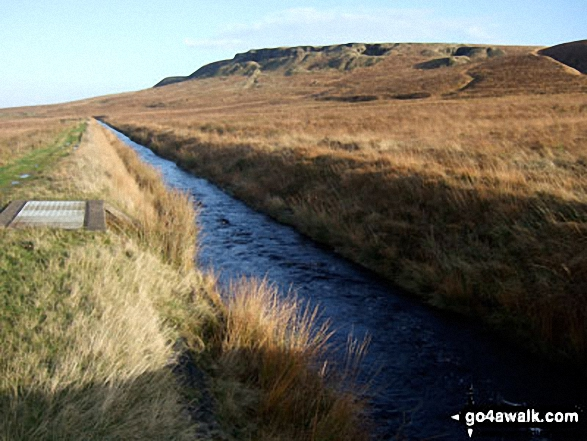 The (now suddenly full) Drainwater Ditch on Binn Moor with Shooters Nab beyond. Walk route map wy106 West Nab and Horseley Head Moss from Meltham photo