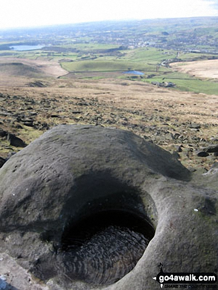Hollingworth Lake from a stone hollowed out by the weather on Blackstone Edge summit