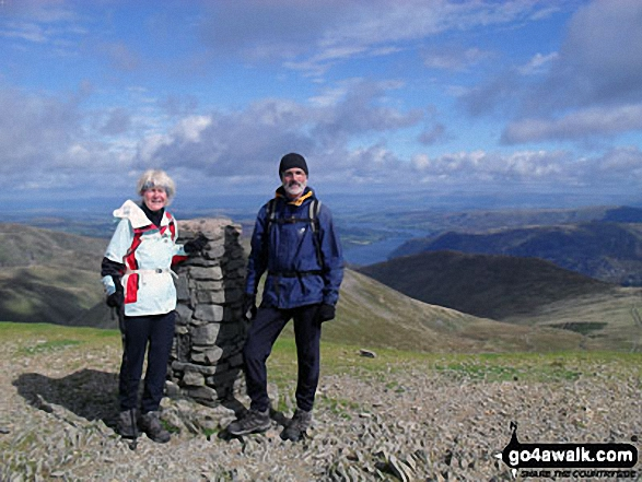 Anthea and Graham on Helvellyn summit with Ullswater in the distance