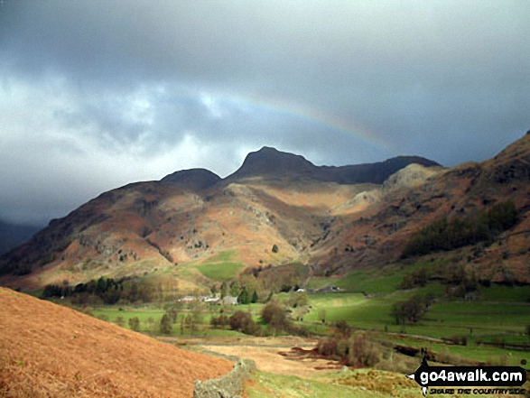 Approaching the (somewhat moody) Langdale Pikes along the Cumbria Wayin Great Langdale below Oakhowe Crag.. Walk route map c281 The Langdale Pikes via North Rake from The New Dungeon Ghyll, Great Langdale photo