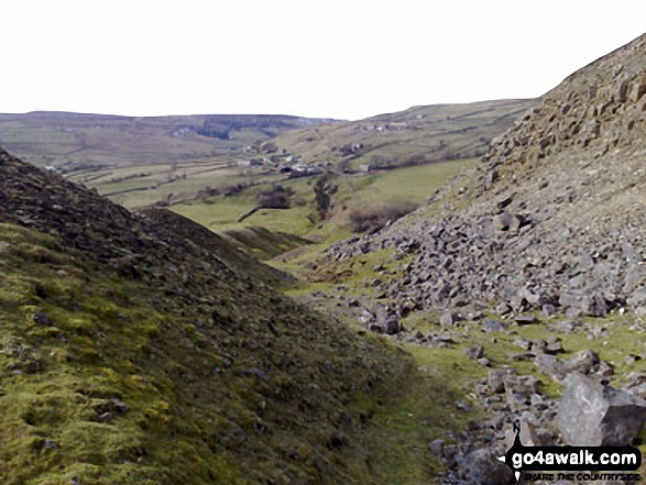 Down through the spoil heaps of Fell End Lead Mine at the NW end of Fremington Edge