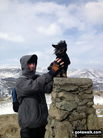 My partner Anthony and our lovely dog Cookie on top of Loughrigg Fell on a blustery Sunday
