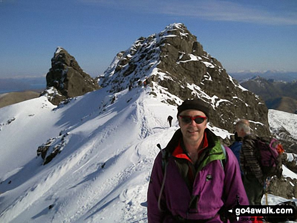 My husband David on Bruach na Frithe on The Cuillin Ridge with the 'tooth' of Am Basteir in the background,<br>Isle of Skye