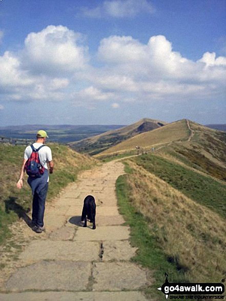One man and his dog, a gorgeous day walking from Mam Tor to Hollins Cross. Walk route map d158 Sparrowpit and Mam Tor from Castleton photo