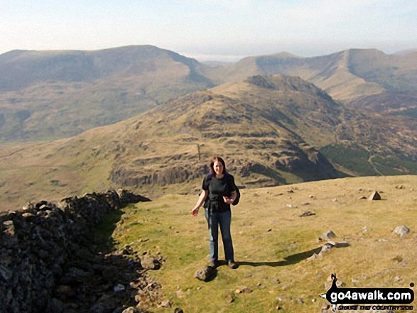 Look! Its me ;-) on Moel Hebog last April with Craig Cwm Silyn (left), Mynydd Tal-y-mignedd (centre right), Trum y Ddysgl (right) on the horizon and Moel Lefn and Moel yr Ogof in the mid-distance Such amazing weather that when I arrived at the top I was able to laze in the sun (no breeze at all!)
