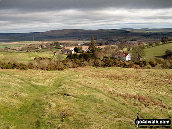Waud House on The St Cuthbert's Way with Wooler beyond from Kenterdale Hill