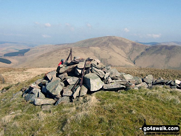 Pikethaw Hill summit cairn with Wisp Hill (Teviothead) beyond