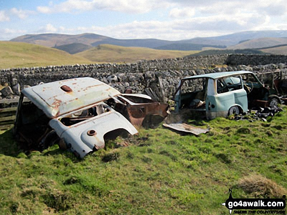 A couple of abandoned cars behind the sheepfold below Ring Chesters