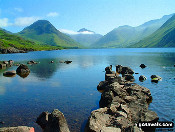 Wasdale Head featuring Yewbarrow (left), Great Gable (centre), Lingmell (right) and the lower slopes of Scafell Pike (right) from across Wast Water