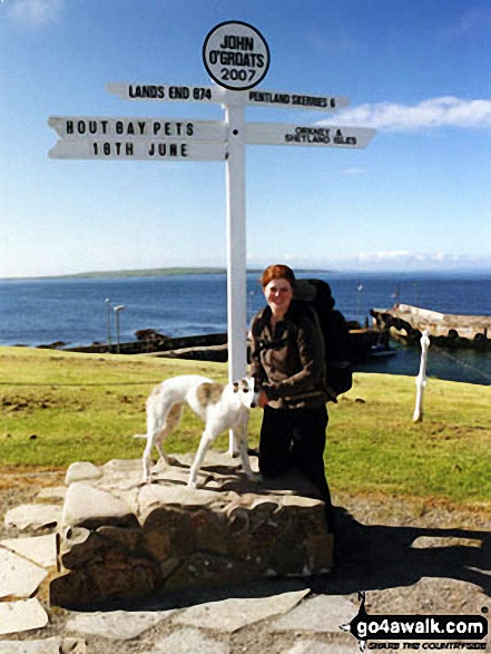 Katherine Arzul and her dog Millie at John O'Groats