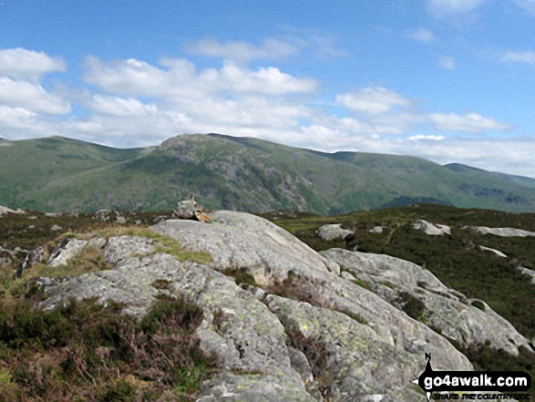 Armboth Fell summit with The Helvellyn massif beyond