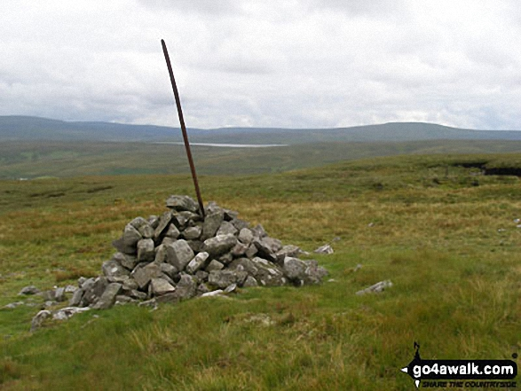 Cairn near Tarn Hole Edge with Cow Green Reservoir in the distance