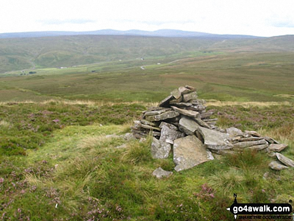 Cairn on western edge of Three Pikes with Viewing Hill beyond