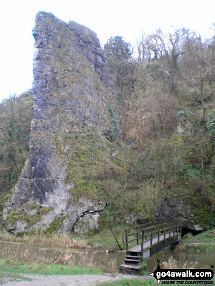 Ilam Rock Bridge with Ilam Rock beyond, Dove Dale near Milldale, . Walk route map s238 Manifold Valley, Ilam, Dove Dale, Milldale, Alstonefield and Wetton from Weag's Bridge photo