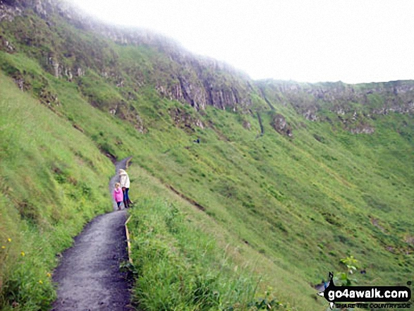 My daughter and I making our way on one of the paths that zigzag to the top of the cliffs overlooking the Giants Causeway