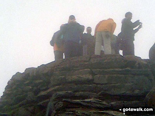 This is my husband Dave on the top of Snowdon. Walk route map gw136 The Snowdon (Yr Wyddfa) Horseshoe from Pen y Pass photo