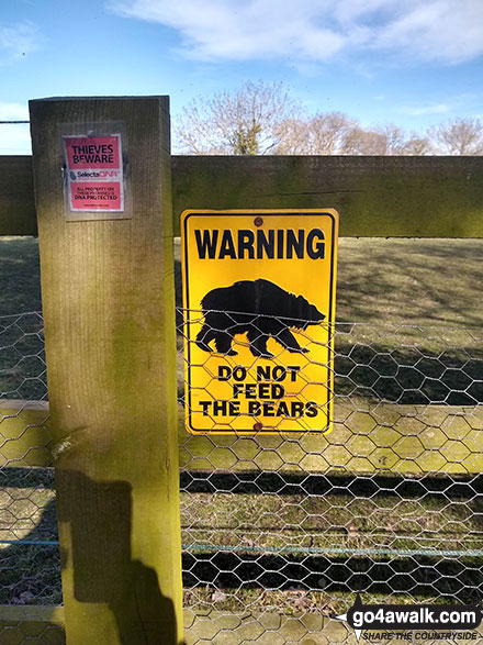 Walk ch102 Dunham Massey and The Bridgewater Canal from Lymm - Warning sign on a fence in Little Bollington