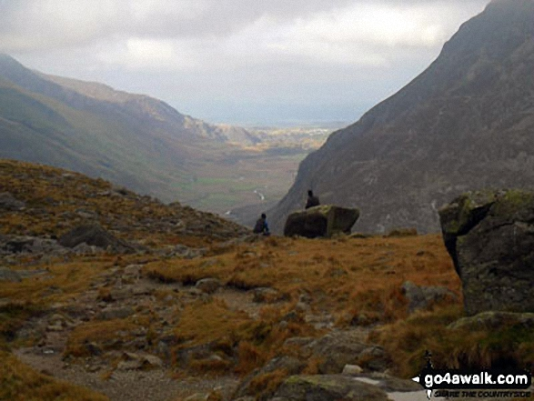 Looking down Nant Ffrancon to Bethesda with Anglesey in the far distance from near Llyn Bochlwyd in the Ogwen valley