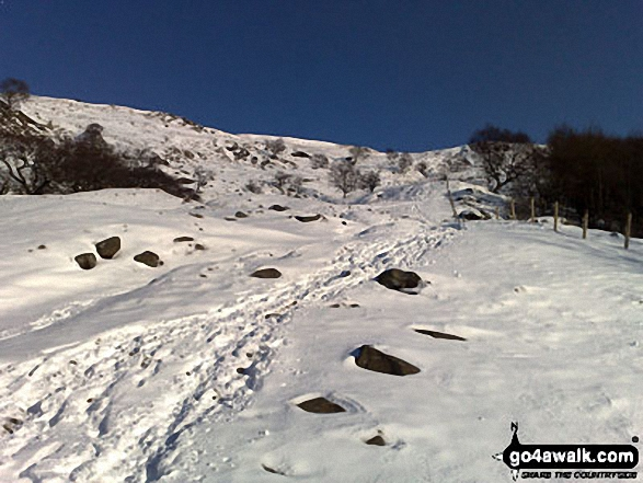 Looking back up to Alport Castles from Alport Dale in the snow
