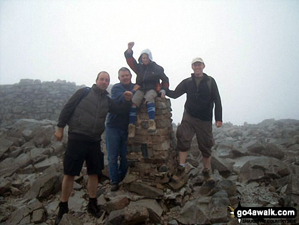 On the summit of Scafell Pike. Walk route map c370 Scafell Pike from Seathwaite photo