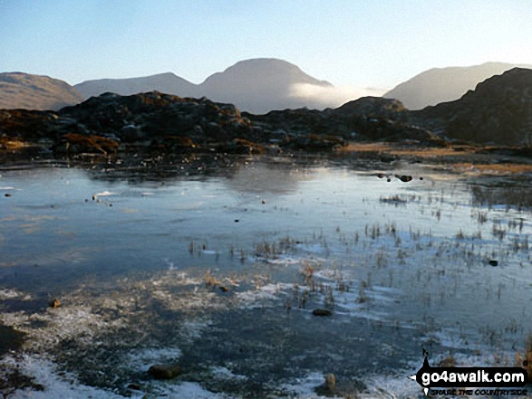 Innominate Tarn on Hay stacks (frozen solid) with Great Gable rising majestically in the background