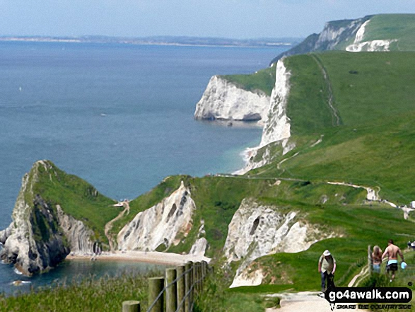 Durdle Door (bottom left) and Bat's Head (centre) with Weymouth beyond from St Oswald's Bay, The South West Coast Path