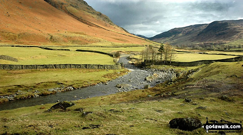 Mickelden Beck flowing through Great Langdale with the lowers slopes of the Landale pikes (left) and Side Pike (right)