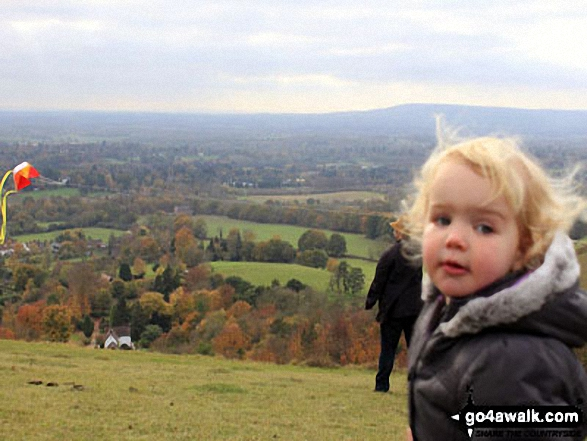 Go Fly a kite: My daughter, Tilly, watching in wonder at her daddy (try) to fly a kite on (a not so windy) Reigate Hill!