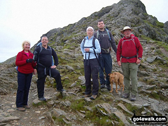 Walk c264 The Grisedale Round from Patterdale - Family group having completed Striding Edge before the last pull up to Helvellyn.