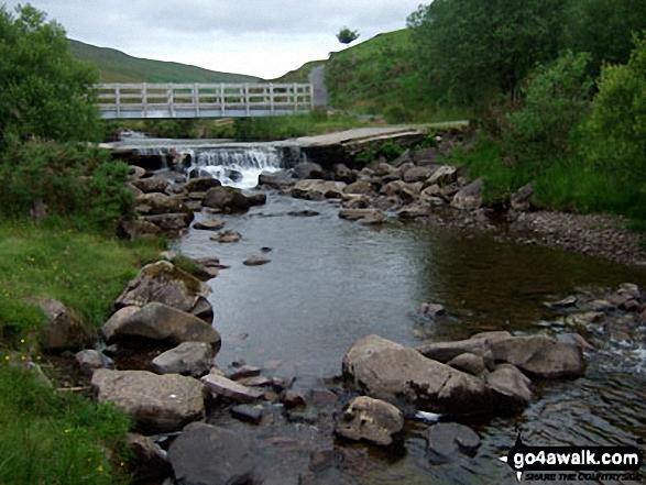 The footbridge over Afon Llia at Blaen Llia Picnic Area