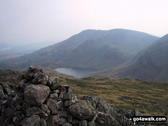Walk c222 Swirl How and Wetherlam from Coniston - Levers Water and The Old Man of Coniston from Black Sails summit cairn
