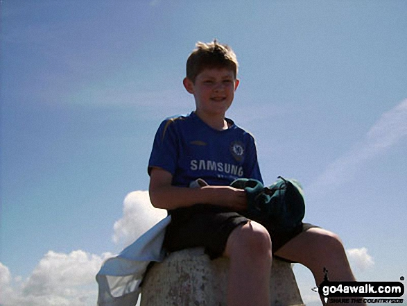 My son Harvey on top of the trig point on Holyhead Mountain