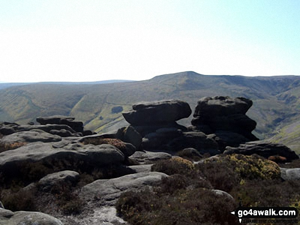 Rock sculptures near Ringing Roger on the edge of The Kinder Plateau (Edale Moor) with Grindsbrook Knoll beyond