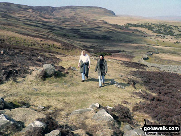 Jakie and Emma trekking up Noon Hill (Cronkley Fell)