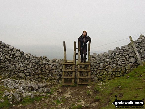 The final stile in Horton in Ribblesdale at the end of the Yorkshire Three Peaks of Challenge Walk