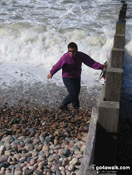 Collecting the traditional pebble (and getting soaked in the process!), St Bees