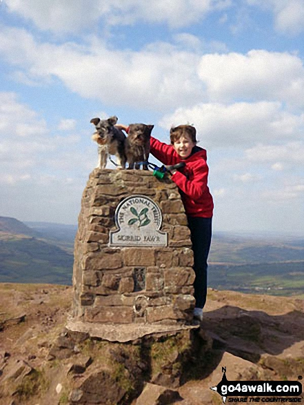 My son Daniel and our 2 dogs Brecon and Maggie at the top of The Skirrid. Walk route map mo128 The Skirrid from Abergavenny photo
