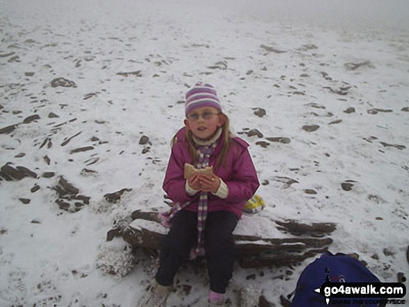 My daughter Ffion (aged 8) on the summit of Pen y Fan