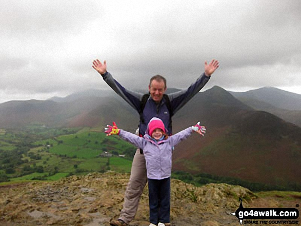 My daughter on top of Cat Bells (Catbells) with her daddy!. Walk route map c399 Cat Bells and Derwent Water from Keswick photo