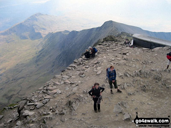 We made it! Sara and Tess on the summit of Snowdon. Walk route map gw107 Snowdon and Yr Aran from Rhyd Ddu photo