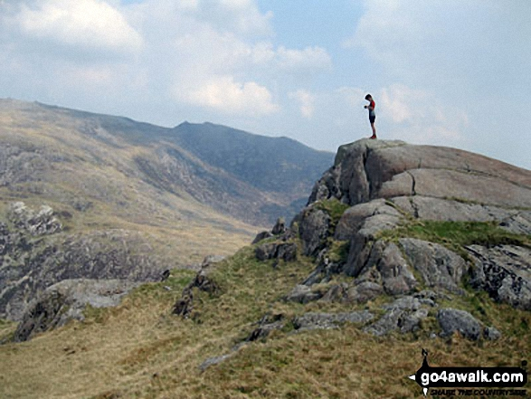 Roman standing in the summit of Craig Fach with Glyder Fawr forming the horizon. Walk route map gw136 The Snowdon (Yr Wyddfa) Horseshoe from Pen y Pass photo