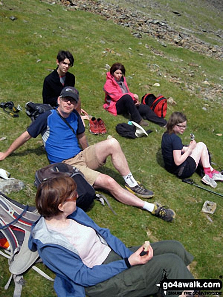 The expeditionists - Tess, Andy, Roman, Sara and Nell take a well-earned break whilst climbing Snowdon via the PYG Track. Walk route map gw100 Mount Snowdon (Yr Wyddfa) from Pen y Pass photo