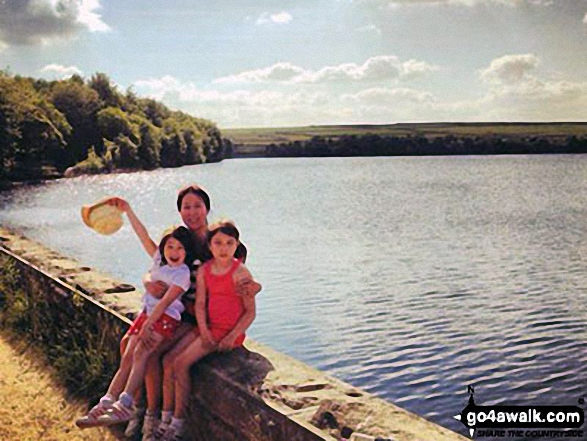 A family walk around Blackmoorfoot Reservoir near Huddersfield on a sunny afternoon