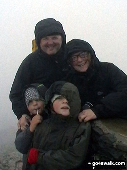 The Johnson-Holme Family on the summit of Mount Snowdon