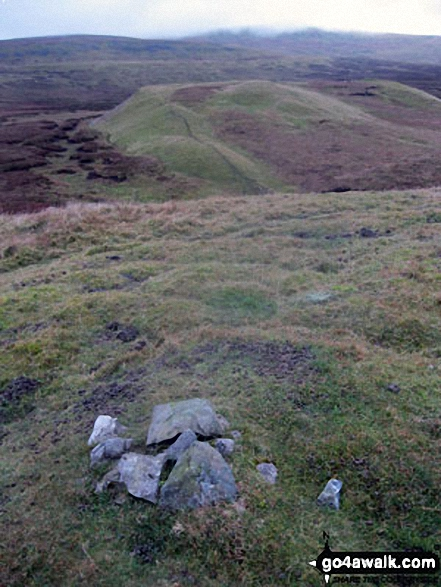 The cairn on Bullman Hills (South Top) summit with Bullman Hills and Cross Fell beyond