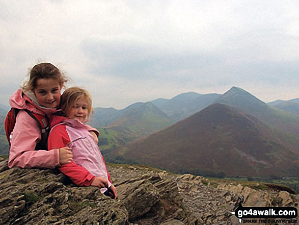 Sofia and Lara on their way up Cat Bells with Causey Pike in the background. Walk route map c399 Cat Bells and Derwent Water from Keswick photo
