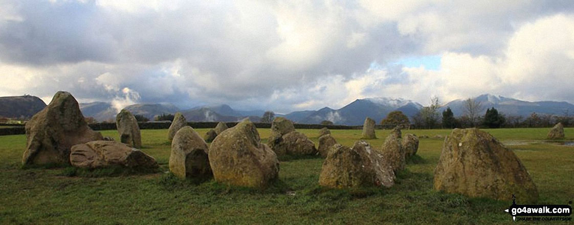 Castlerigg Stone Circle with the shoulder of Walla Crag (left), Maiden Moor, Cat Bells (Catbells), Sail, Causey Pike, Barrow and Grisedale Pike in the background