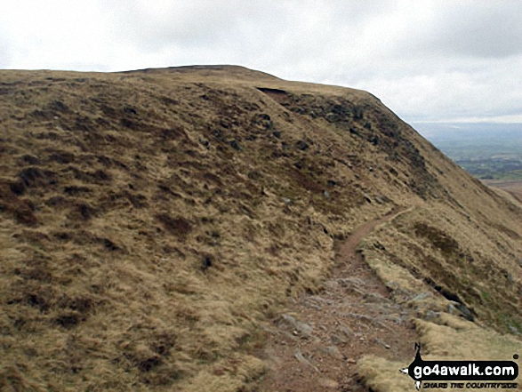 Approaching the summit of Pendle Hill (Beacon or Big End) from the South