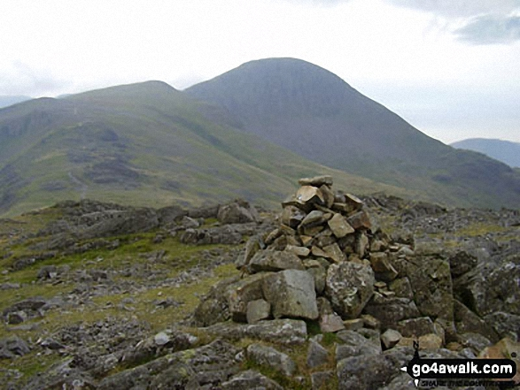 Brandreth summit cairn with Gillercomb Head leading up to Green Gable with Great Gable looking majestic in the background